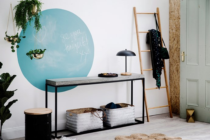 If you can't choose between a neutral hallway or going big with bold colour, why not do both? Take cues from this industrial style hallway featuring a circle in blue chalkboard paint. *Photo: Chris Warnes / bauersyndication.com.au*