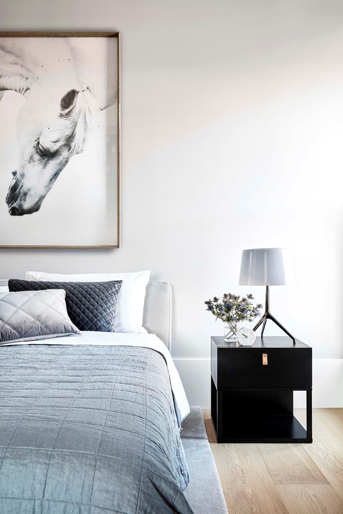 Calming grey  tones and the layering of texture make for a restful master bedroom. Christopher Elliott Design 'Mobi' bed, Grazia & Co 'Leo' bedside table with Foscarini 'Lumiere XXL' table lamp.