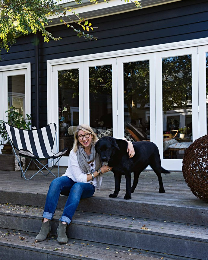 """Susie with Monty the labrador outside the main living area, which was extended into the garden to let in more natural light. """"For natural light in Bowral, you really need to look north, and unfortunately all this back area is south-facing,"""" says Susie.