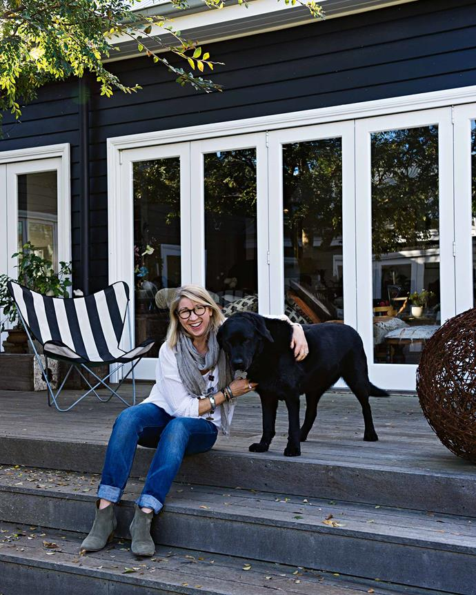 """Susie with Monty the labrador outside the main living area, which was extended into the garden to let in more natural light. """"For natural light in Bowral, you really need to look north, and unfortunately all this back area is south-facing,"""" says Susie."""