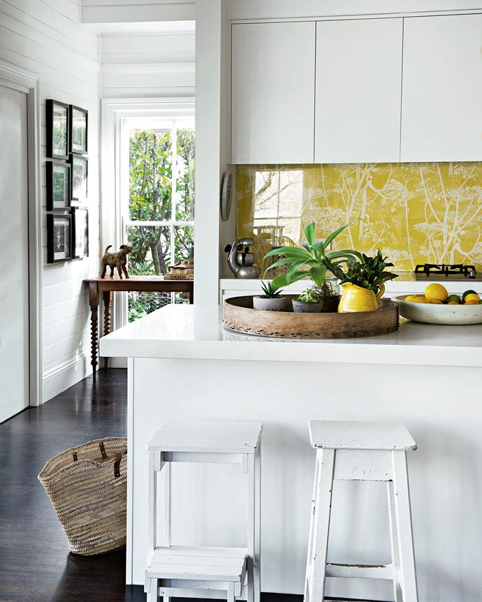 """Susie planned the freestanding kitchen wall that hides a walk-through pantry. The glass splashback protects the [Cole & Son](https://www.cole-and-son.com/en/