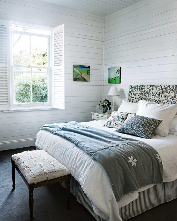 In the main bedroom, two paintings by Goulburn's Jenny Bell offset a headboard covered in an embroidered crewel fabric.