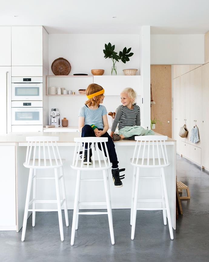 "In the open-plan kitchen, the wooden bench has been varnished three times to protect against wear and tear. White paired with light timber highlight the [Scandinavian design](https://www.homestolove.com.au/scandinavian-interior-design-6907|target=""_blank"") inspiration."