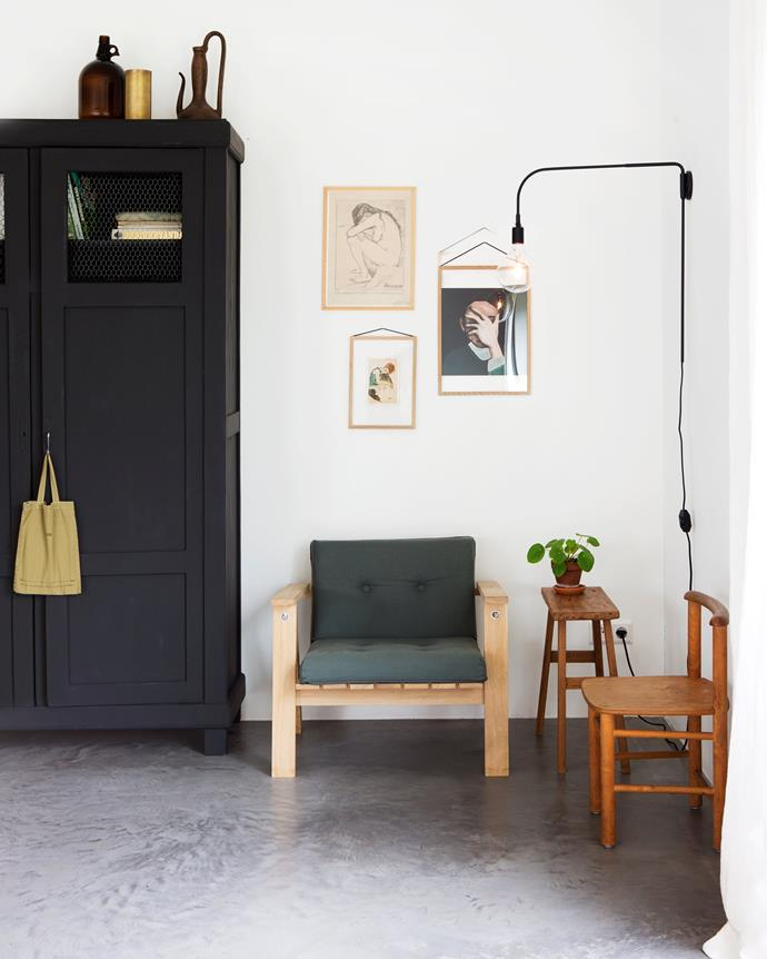 "This corner of the dining room is Tessa's favourite spot in the house. ""I love to drink a cup of coffee here in the morning,"" she says. The old wooden cupboard used to be in Guss and Polle's room, and Tessa painted it in a [Farrow & Ball](http://www.farrow-ball.com/