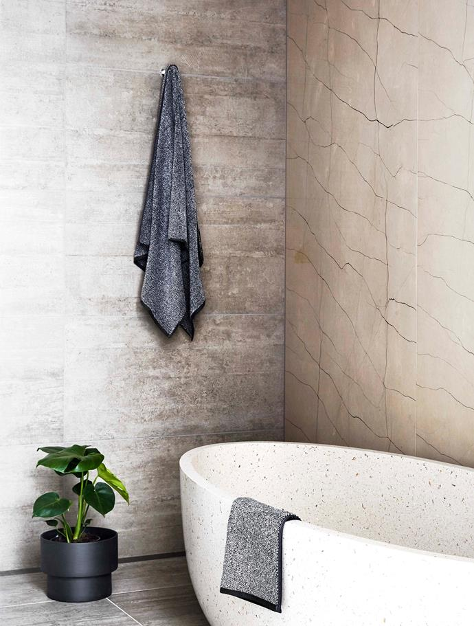A terrazzo stone bathtub is the centrepiece of this spa-like main bathroom.