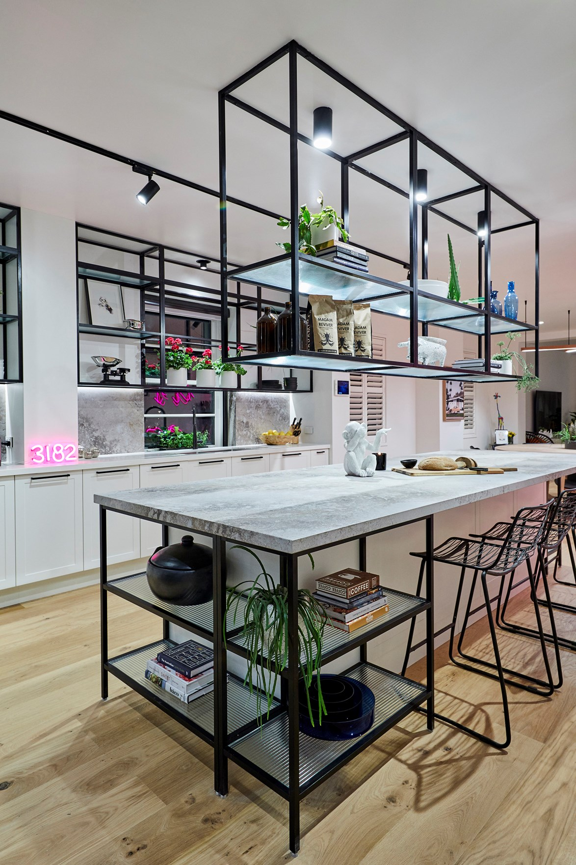 "The Block 2018 was packed with [trendy kitchen design ideas](https://www.homestolove.com.au/the-block-2018-kitchen-trends-19242|target=""_blank""). But the stand-out kitchen of the season would have to be the New York ""cafe style"" space created by Hans and Courtney in the challenge apartment. The gantry shelving was made from anodised matt black framing and, you guessed it, panels of fluted glass."
