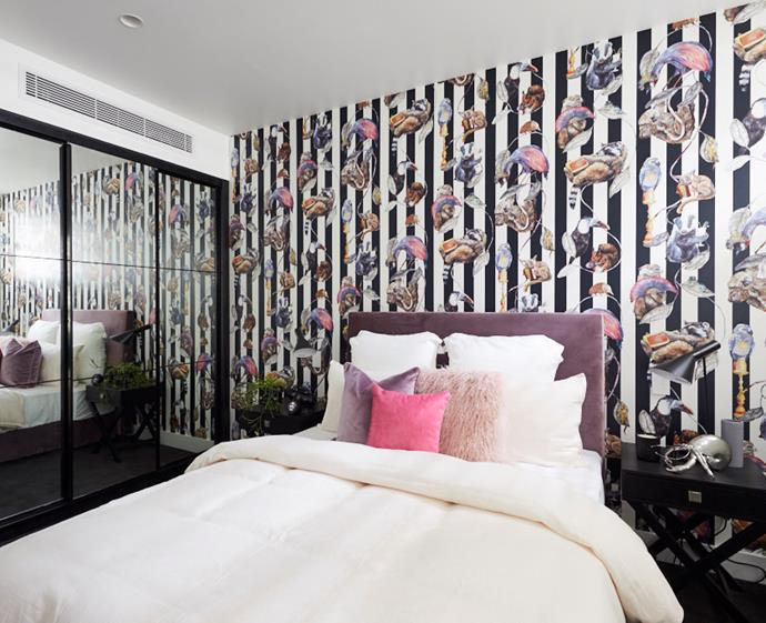 "[Statement wallpaper](https://www.homestolove.com.au/botanical-wallpaper-trend-19192|target=""_blank"") was a running theme throughout the apartment and this wild and whimsical print in Courtney and Hans' guest bedroom won them first place in the first round of room reveals."