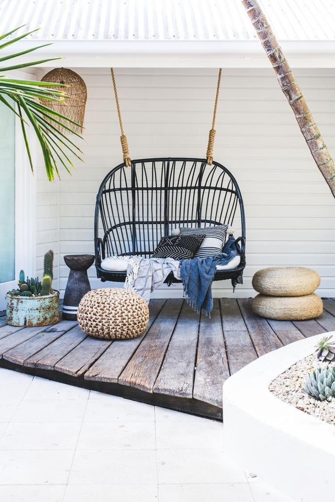 """'Lucy' Love Seat in Black, $795, [Byron Bay Hanging Chairs](https://www.byronbayhangingchairs.com.au/collections/hanging-chairs/products/the-lucy-love-seat