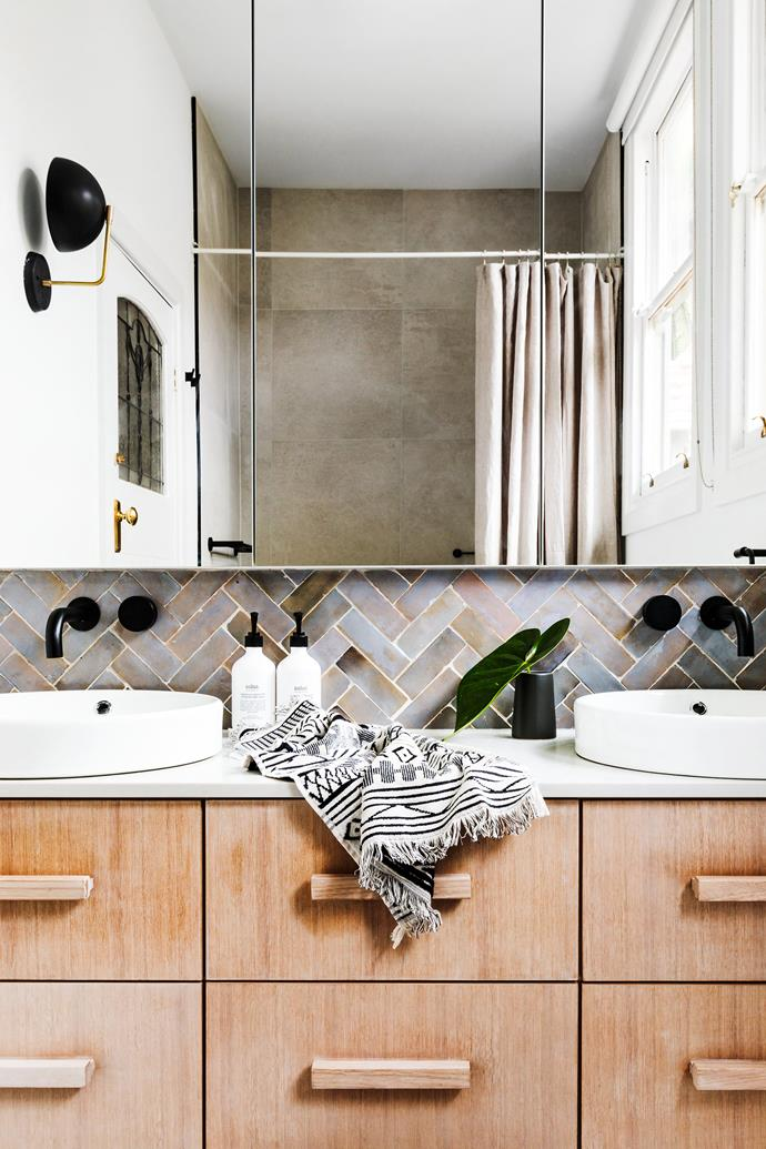 The bathroom was originally two rooms, so a wall was removed and the ceilings raised. Everything was custom-designed by Studio Ezra.
