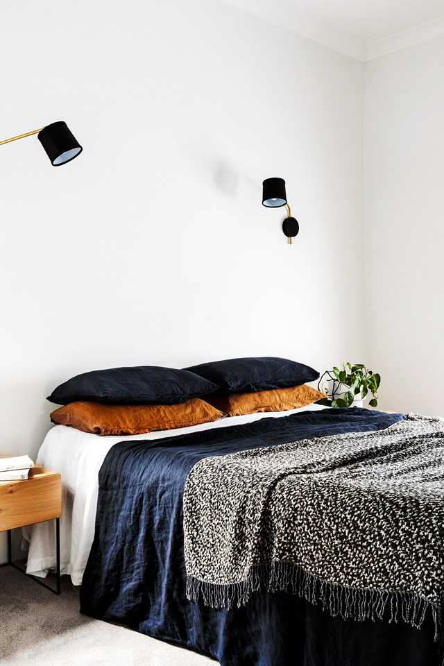 "**Navy and terracotta:** Navy and terracotta is a match made in heaven in the bedroom of this [renovated Edwardian home](https://www.homestolove.com.au/edwardian-home-quick-renovation-19217|target=""_blank""). The navy blue offers up rich yet ultra-relaxing aesthetic, while the terracotta pillow cases inject warmth. The bedlinen is a mix from In Bed and Major-Minor. *Photo:* Amelia Stanwix 