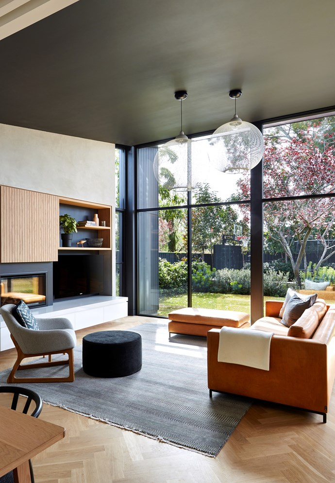"**'Personality plus by Rebecca Ryan Architect:** ""The owners wanted to feel like they were sitting in the garden,"" says architect Rebecca Ryan, who was more than happy to run with the indoor-outdoor brief for this Adelaide family room, which is part of a larger open-plan space. Key to achieving this feel is the glazed rear wall (shaded by deep eaves), offering an almost-uninterrupted vista, and the room's floor level, perfectly in line with the lawn beyond. A pair of Moooi 'Non Random' pendant lights provides texture and interest without detracting from the leafy view. Built-in joinery ensures a place for everything. ""It's all that we envisaged and more,"" says owner Sean. *Photo:* Sam Noonan"