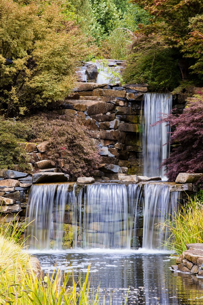 In the Water Garden, a 20m-high waterfall with stone wall is a focal point.