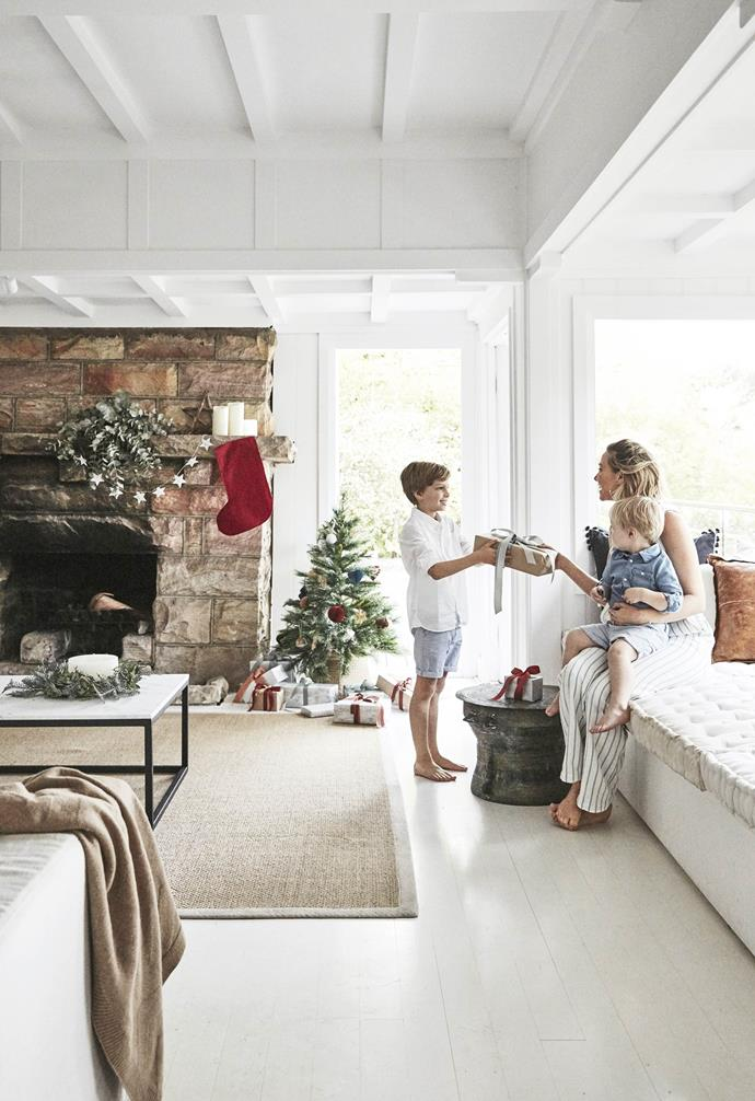 "**Living area** Siobhan exchanges gifts with Oliver and Sasha on a window seat, packed with cushions and a throw from [Spence and Lyda](https://www.spenceandlyda.com.au/|target=""_blank""
