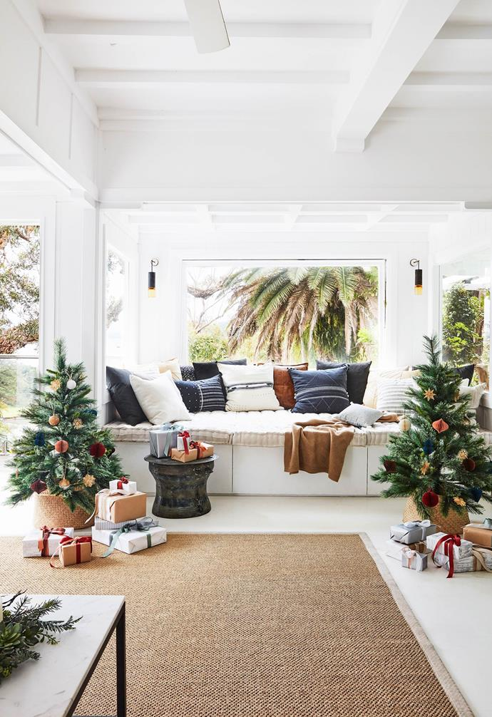 "**Living area** Calm colours and natural textures, such as the large rug from The Natural Floorcovering Centres, combine to create an easy-living mood in this Palm Beach home. Presents wrapped in paper and ribbon from [Vandoros](https://www.vandoros.com.au/|target=""_blank""