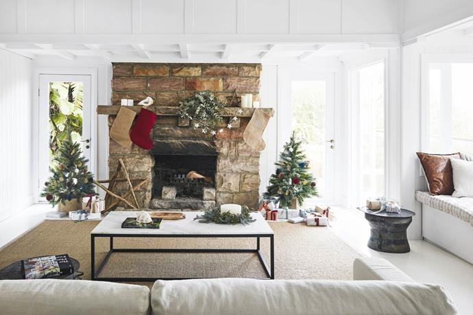 "**Living area** The imposing stone fireplace and impressive timber mantel are the perfect spot for a seasonal display including homemade Santa sacks and driftwood stars from Delight Decor. The sofa, from [MCM House](https://mcmhouse.com/|target=""_blank""