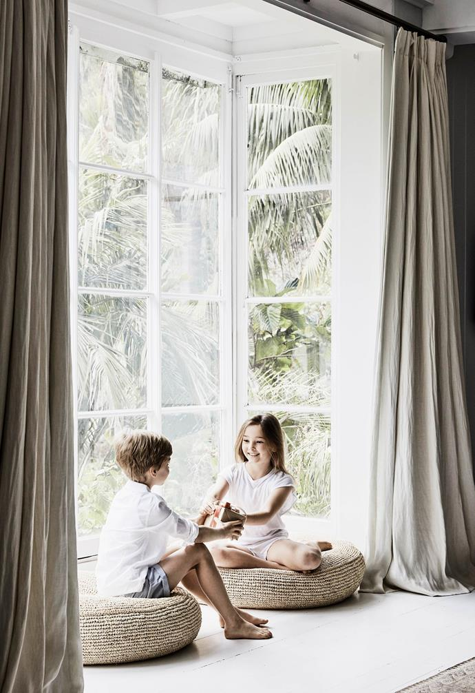 "**Master bedroom** Mia and Oliver sit in the main bedroom's tall bay windows, which are hung with curtains made up in textiles from [Unique Fabrics](http://www.uniquefabrics.com/|target=""_blank""