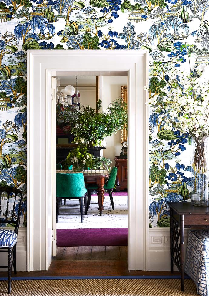 "Maine House Interiors didn't hold back when it came to styling the entrance hallway. Vibrant wallpaper in an oriental pattern transformed the once threadbare space into a technicolor dream. Visible through the doorway is the dining room styled by [Moss](https://www.mossmelbourne.com.au/|target=""_blank""