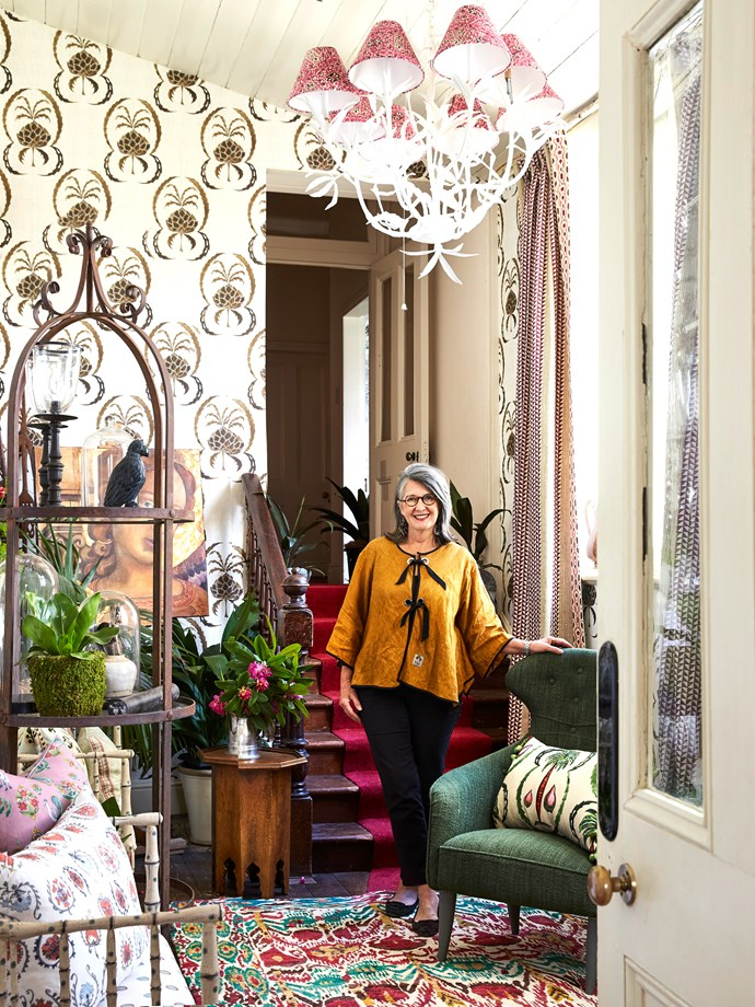 Como by Design is the brainchild of interior designer Tigger Hall, who is pictured here in the upstairs walk-through she created as part of the event. Her space features a harmonious layering of upholstered cushions and fun fabrics.