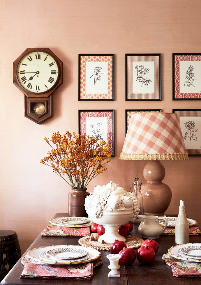 An informal dining room was created in the kitchen space revamped by Adelaide Bragg. The space features a controlled mix of pattern in feminine shades of peaches and pinks.