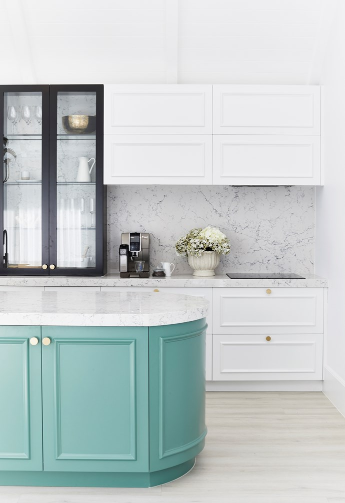 Cabinets painted in Dulux White On White provide the perfect contrast against the statement cabinetry painted in Dulux Lorna. A De'Longhi Dinamica Plus coffee machine sits stylishly on the white benchtop.