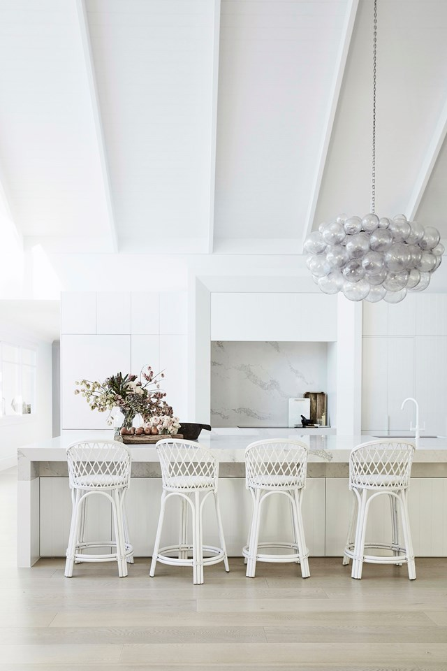 """Bonnie Hindmarsh's [country coastal kitchen](https://www.homestolove.com.au/three-birds-bonnie-hindmarshs-modern-coastal-home-6802 target=""""_blank"""") - complete with a """"mammoth"""" island bench - was made for entertaining. It includes a servery window, butler's pantry and a sleek white aesthetic."""