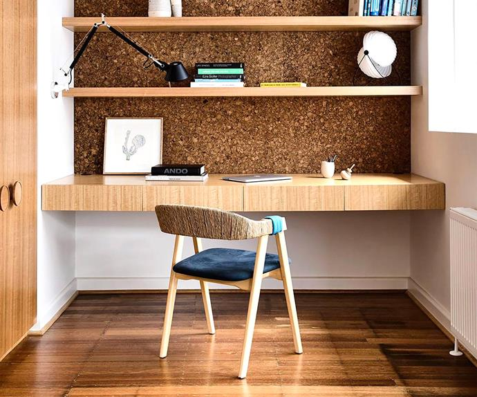 Home office with timber and cork shelving