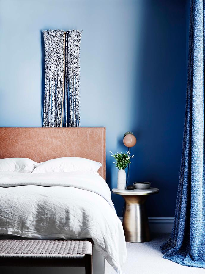 In the main bedroom, a leather slip cover has been added to the bedhead. Bedside table from West Elm.