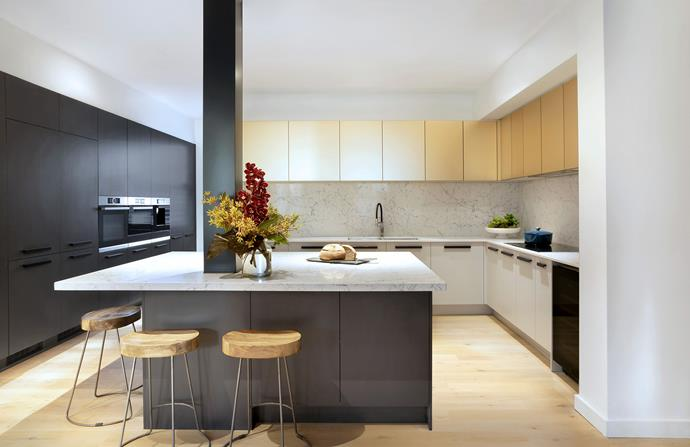 Metallic 'Champagner' kitchen cabinetry shines bright in Courtney and Hans' kitchen.