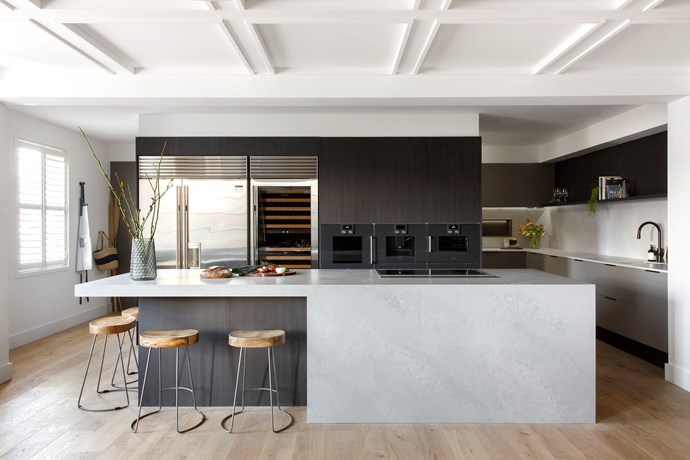 A mix of dark tones and textures adds depth and drama to Kerrie and Spence's kitchen.