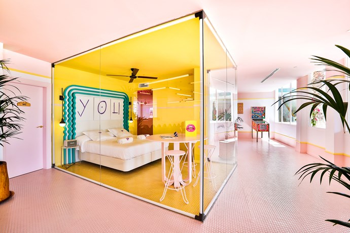 A transparent yellow cube in the lobby is part of the hotel's Zero Suite Residencies. The program runs one weekend a month and invites young artists to stay for free in the glass suite and create artworks. Guests can then interact and watch the process.