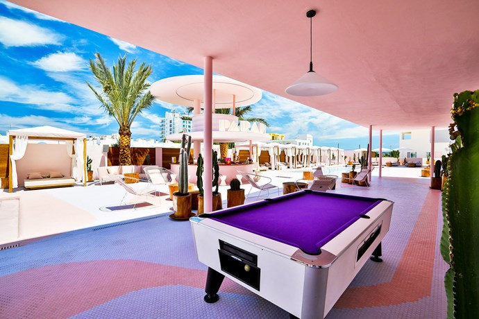 Outside there are two pools, a pink and lavender circular bar and cabanas.