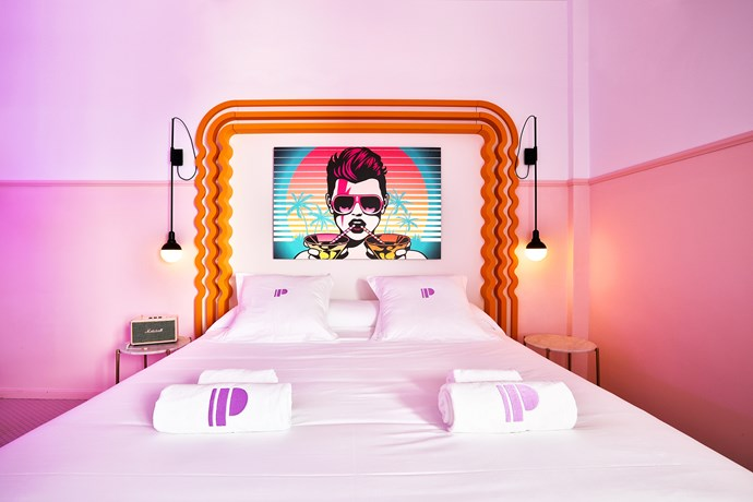 In the rooms, statement bedheads are inspired by Ettore Sottsass' Ultrafragola mirror.