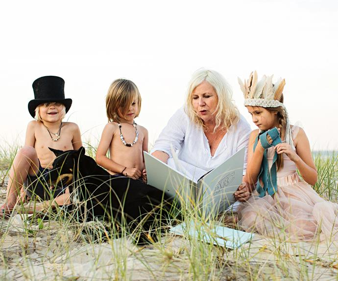 Vicki reads on the beach, in the company of Sebastian and Malakai (both six), Ava (nine), and Tippy the kelpie. The siblings and their family are friends of Vicki's, while her three grandchildren often visit and stay in her little guest bedrooms.  | Photo: Kara Rosenlund