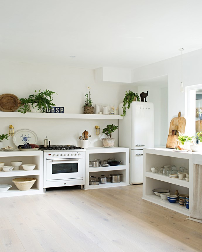 "Natural light floods into her home through large windows, including a bi-fold window in the kitchen that opens out to the garden. ""I love being able to snip fresh herbs while I'm cooking,"" says Vicki. 