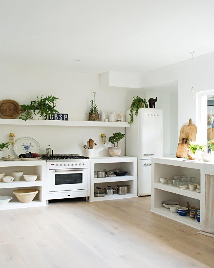 """Natural light floods into her home through large windows, including a bi-fold window in the kitchen that opens out to the garden. """"I love being able to snip fresh herbs while I'm cooking,"""" says Vicki. 