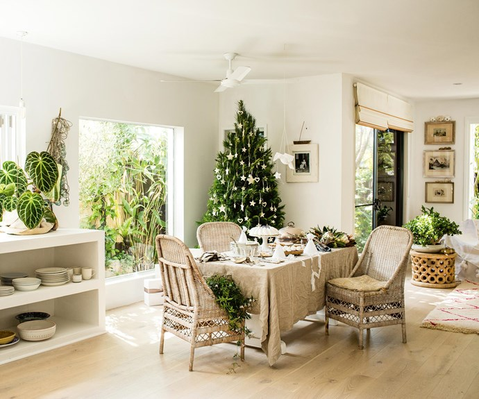 Vicki's sun-dappled dining room, overlooking the garden, is the perfect spot for a relaxed Christmas lunch. The tree from Ashgrove-based [Real Christmas Trees](http://www.realchristmastrees.com.au/) is decorated with pieces from [Paper Boat Press](http://paperboatpress.com/), while the bird and star mobile and linen party hats are from [Oh Mee Oh Mai](http://www.ohmeeohmai.com/). The cakes and biscuits are from [Jocelyn's Provisions](https://jocelynsprovisions.com.au/) and floral arrangements are by Dezley Hughes. The chairs were picked up at Sydney's Alexandria Auctions more than 10 years ago. Outside, a bamboo screen covered with ivy and jasmine was built along the length of the yard for privacy. | Photo: Kara Rosenlund