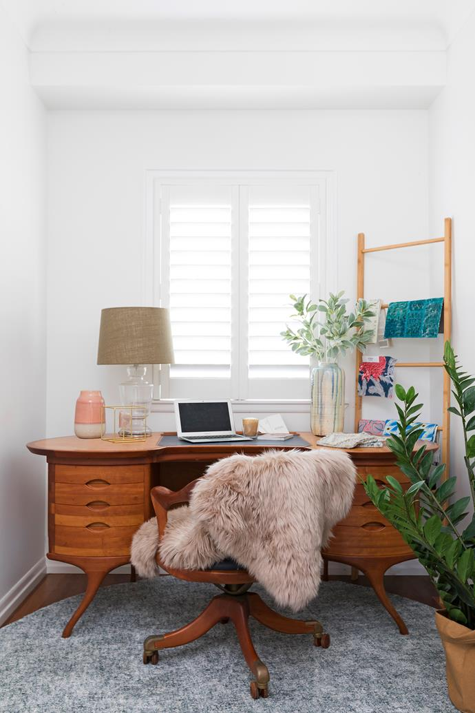 """The mid-century modern desk in the study belonged to Holly's dad. """"It's a beautiful piece – not one nail was used in its construction,"""" she says."""