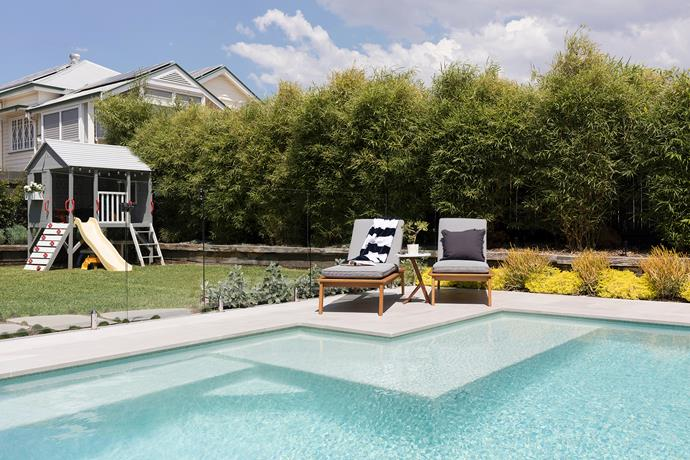 The clever patio design creates a formal space for a pair of sun loungers by the swimming pool.