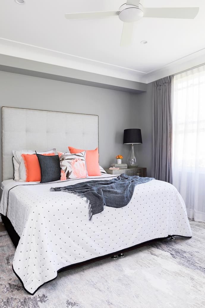 """""""Our bedroom is so large, it has a hotel feel to it,"""" says Holly. She loves bedheads and made this one. Linen from L&M Home."""