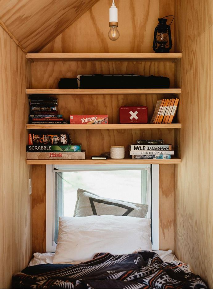 Each cabin has a collection of board games and books to while away the time one would normally spend browsing their phone. | **