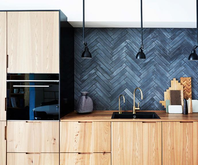 "**All in the texture** ""I love seeing the grain in the elm wood, and it gives life to the kitchen. You can see that the fronts are cut out of one large piece of wood, so the grain continues from one drawer to the next,"" says Anitta."