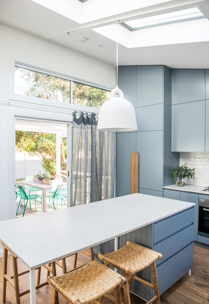 **Kitchen goals** The simple pendant light accentuates the skylights over this pared back kitchen with blue cabinetry.