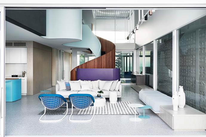 The light-filled living room is an extension of the outdoors. A breeze block wall filters soft light to the interiors.