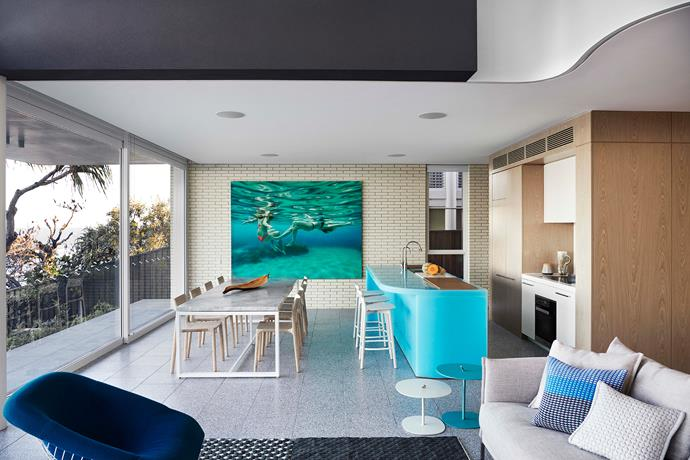 A Martine Emdur artwork complements the turquoise island bench with its line-up of Mattiazzi 'Branca' barstools from District.