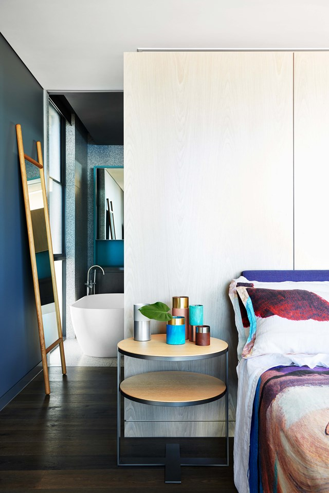 "Beyond the master bedroom is a luxe ensuite bathroom clad in terrazzo tiles. The seaside location of this [Palm Springs style beach house](https://www.homestolove.com.au/palm-springs-style-beach-house-19258|target=""_blank"") in Noosa meant selecting a palette of materials that could cope with the harsh coastal elements and lots of sand. *Photo: Fiona Susanto / Styling: Emma Elizabeth / Story: Belle*"