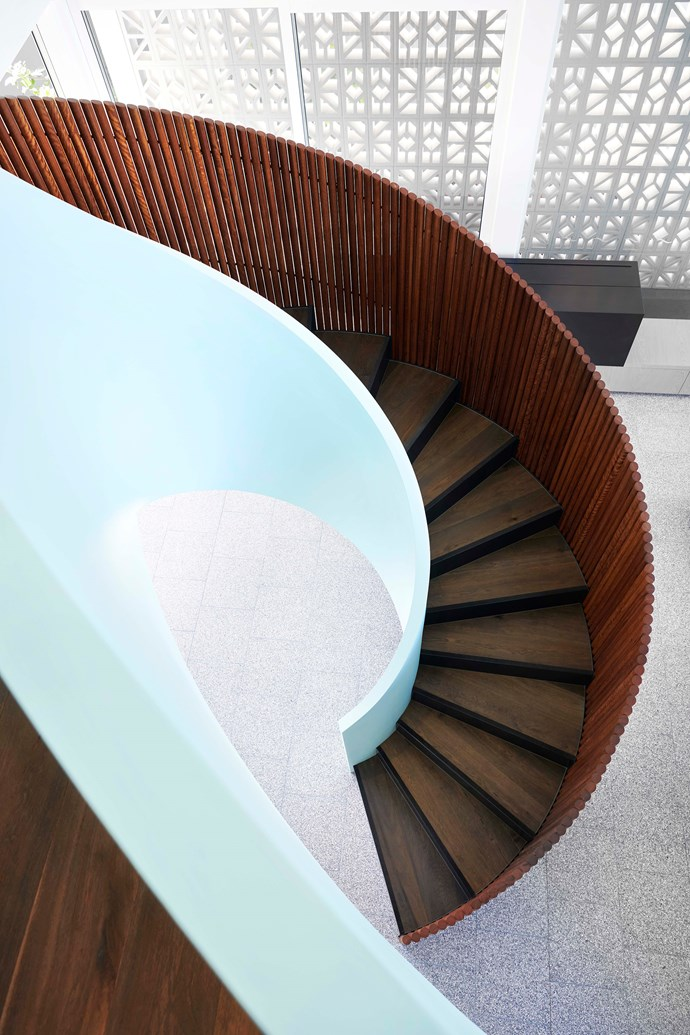 Timber battens frame the spiralling internal staircase. The robust terrazzo flooring is forgiving of sandy footprints.