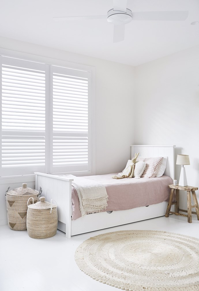 """**Girls' bedroom** Pastel pink bedlinen on the pull-out bed and the woven baskets and rug create a calm haven for the girls. Bedlinen, [Cultiver](https://cultiver.com.au/