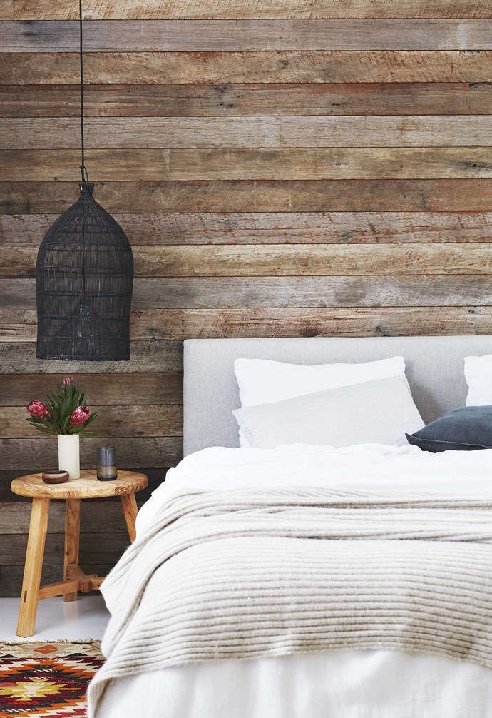 """**Main bedroom** A bedhead made by Emma works together with the timber wall, stool, black pendant and [Tigmi Trading](https://tigmitrading.com/
