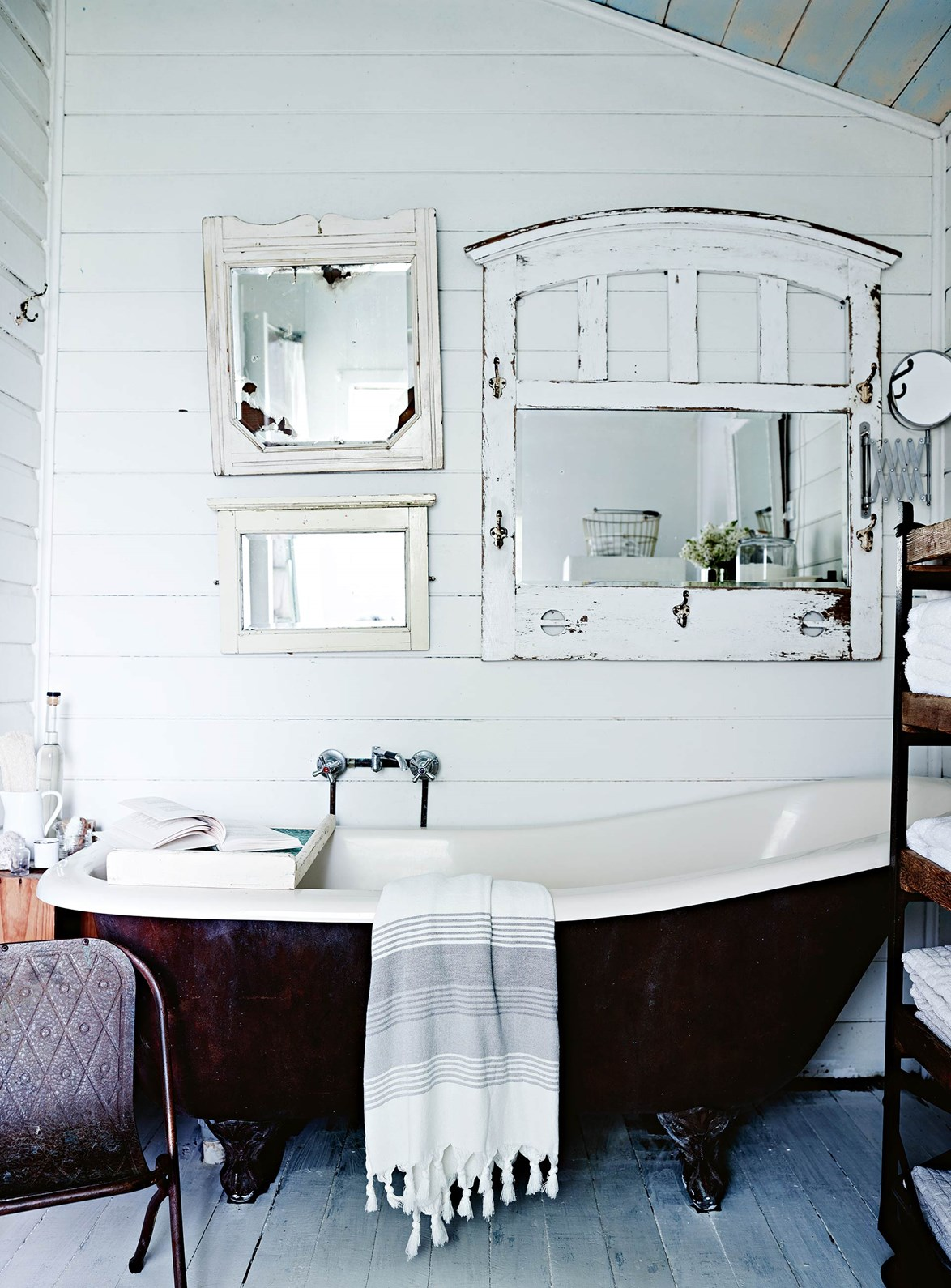 "Upcycled mirrors and vintage furniture in the bathroom of a [dressmakers cottage in Byron Bay](https://www.homestolove.com.au/dressmakers-white-vintage-interior-in-the-byron-bay-hinterland-13719|target=""_blank"") evoke a sense of bohemian country chic. *Photo: Mark Roper / Story: Country Style*"