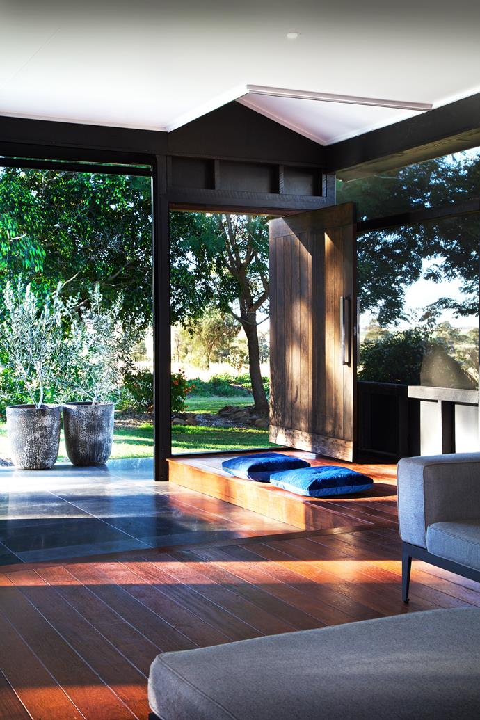 Sydney blue-gum decking and door. Wall cladding in Ecoply structural plywood. Manual pull-down screens in black aluminium, Freedom Retractable Screens. Timber stained Resene Woodsman in Crows Head. *Photo:* Kylie Hood